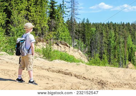 Traveller Boy With Backpack In The Forest