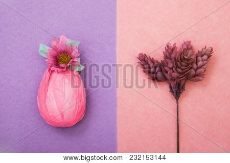 The Egg Is Wrapped In Gift Pink Paper With Mint Green Ribbon And Flower. Sprig Of A Plant With Cones