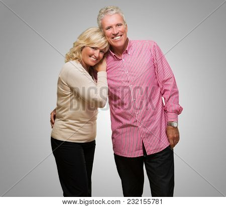 Portrait Of Happy Couple In Love against a grey background