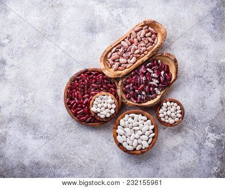 Assortment Of Various Beans In Wooden Bowls. Top View