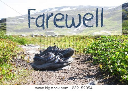 English Text Farewell. Trekking Shoes On Hiking Path In Norway. Mountains In The Background