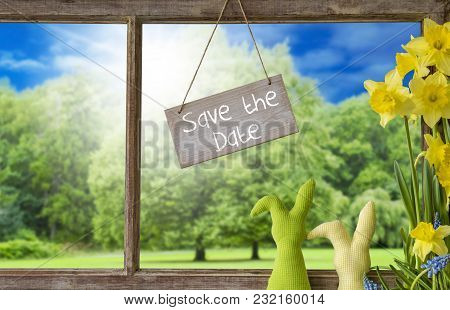 Sign With English Text Save The Date. Window Frame With View To Beautiful Scenery Like Trees And Sun