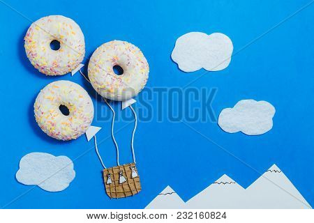 Creative Food Minimalism, Donut In Shape Of Aerostat In Blue Sky With Clouds, Mountains, Top View, C