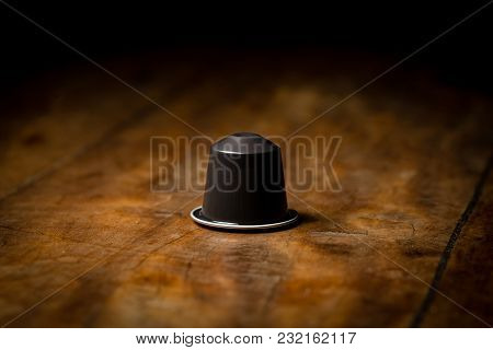 Coffee Pod On Wooden Table. Brown Pod.