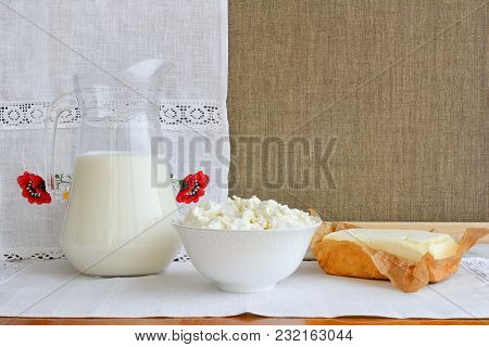 Still Life Of Dairy Products On A Background Of A Towel With Embroidery ..of Red Poppies. Home Cotta