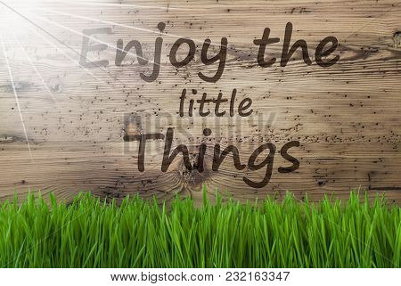 English Quote Enjoy The Little Things. Spring Season Greeting Card. Sunny Aged Wooden Background Wit