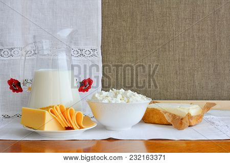 Still Life Of Dairy Products On Background Of Towel With Embroidery ..of Red Poppies. Home Cottage C