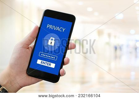 Hand Using Smart Phone With Privacy Device And  Password Login On Screen Over Blur Background, Cyber