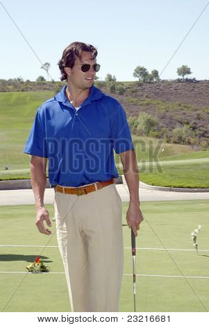 MOORPARK, CA - AUG. 29: Scott Elrod practices at the putting green at the 4th annual Scott Medlock-Robby Krieger Concert & Golf Classic on Aug. 29, 2011 at Moorpark Country Club in Moorpark, CA.