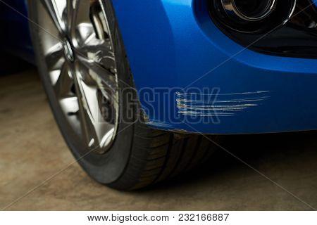 Dent Car Scratch Close-up. Crashed Car In Accident