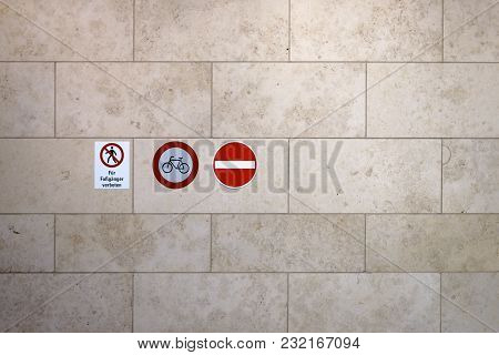 Red Traffic Signs Such As Passage Forbidden On A Marble Wall