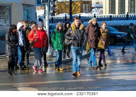 Moscow, Russia - March, 11, 2018: Pedestrians cross the road in a center of Moscow