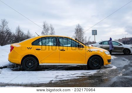 Moscow, Russia - March, 11, 2018: taxi on the parking in Moscow