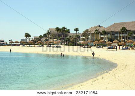 Banana Island, Doha - March 14, 2018: Sunseekers enjoy a break on Qatar's luxury Banana Island resort.