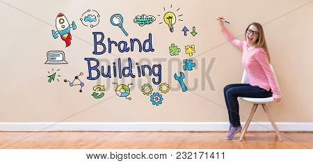Brand Building With Young Woman Holding A Pen In A Chair