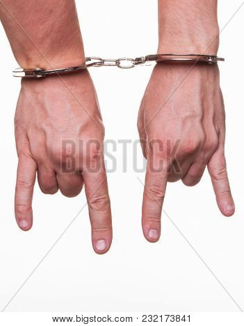 Male Hands In Police Handcuffs Showing Gesture Isolated On White Background