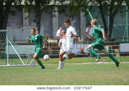 KAPOSVAR, HUNGARY - SEPTEMBER 5: Unidentified players in action at the Hungarian National Championship under 17 game Kaposvar (white) vs. Nagyatad (green) September 5, 2011 in Kaposvar, Hungary.