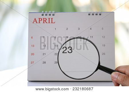 Magnifying Glass In Hand On Calendar You Can Look Twenty-three Day Of Month,focus Number Twenty-thre