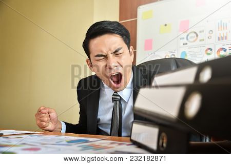 Depressed Angry Young Asian Businessman Is Yelling. Angry. Stress.