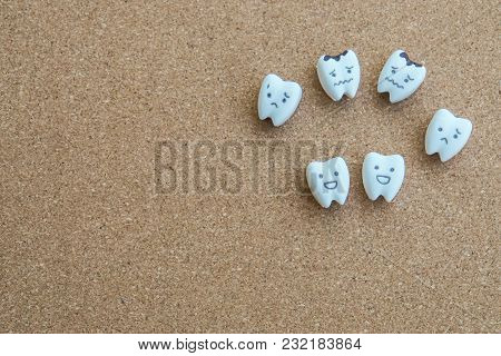 Cute Teeth Cartoon Of Health And Decayed Icon On Wooden Cork Background