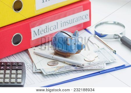 Clean Insurance Form, Piggy Bank, Notebook And Money