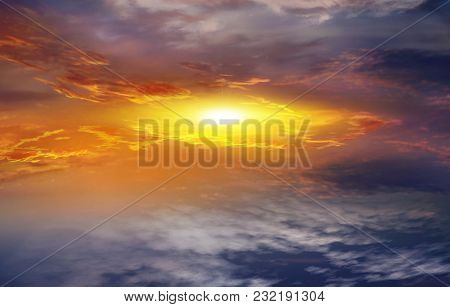 Colorful Sunset . Colorful Clouds With Lens Flare . Beautiful Heavenly Landscape With The Sun In The