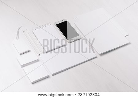 White Blank Stationery - Label, Notepad, Letterhead, Envelop, Phone On Soft White Wooden Plank, Blan