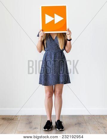 Girl holding orange forward icon