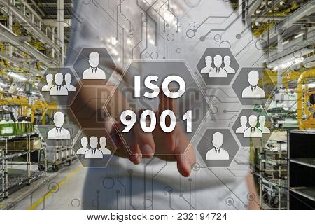 The Businessman Chooses  Button  Iso 9001 On The Touch Screen With A Futuristic Background .the Conc