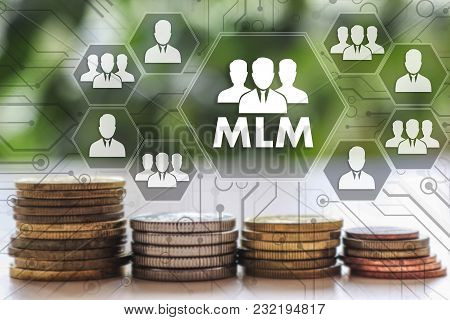 Multi-level Marketing. Mlm On The Touch Screen With A  Blur Financial Background .the Concept Mlm, M
