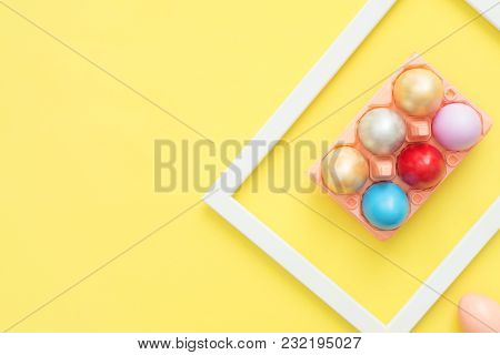 Flat Lay Top View Colorful Easter Egg Painted In Pastel Colors Composition On Yellow Pastel Color Ba