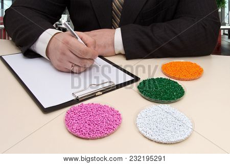 Businessman In The Office Signs A Contract For The Supply Of Plastic Granules For Industry. Plastic