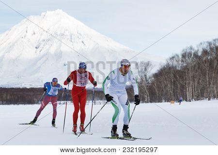 Petropavlovsk City, Kamchatka Peninsula, Russian Far East - Feb 10, 2018: Skiers-men Running Along T