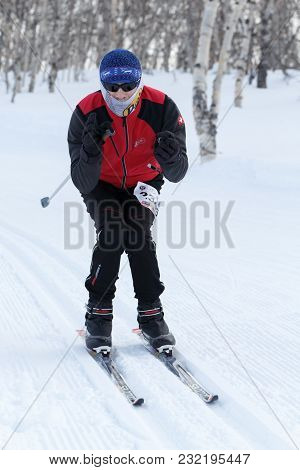 Petropavlovsk, Kamchatka Peninsula, Russia - February 10, 2018: Male Skier In Red-black Sports Suit