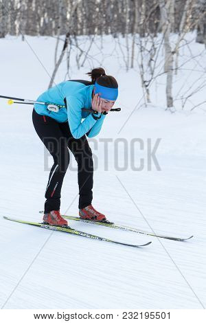Petropavlovsk, Kamchatka Peninsula, Russia - Feb 10, 2018: Sportswoman Skier In Blue-black Sports Su