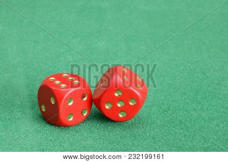 Red Dice With Golden Points Closed  Up On Green