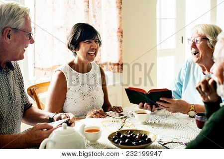 Group of senior friends hanging out together
