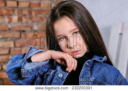 Portrait Beautiful Teenager Girl Brunette Touching Her Face. Fashion Model Tests Young Caucasian Wom