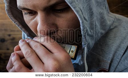A Harmonica In The Hands Of A Man