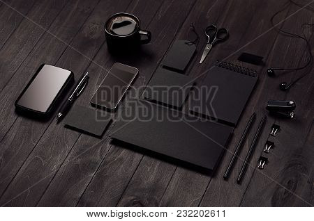 Blank Black Corporate Stationery On Dark Stylish Wood Background, Inclined. Branding Mock Up For Bra