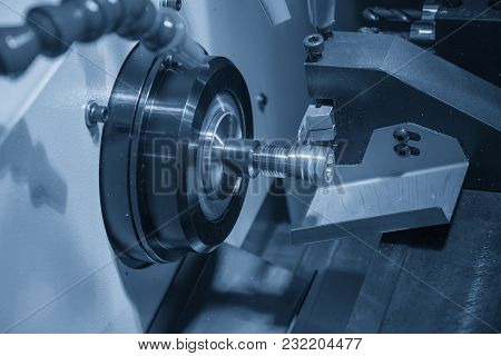 The Cnc Lathe Machine Cutting The Small Part In The Light Blue Scene.