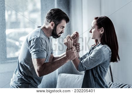You Lied To Me. Anxious Furious Angry Man Standing Opposite A Woman Holding Her Hands And Looking At