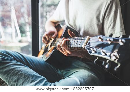 Man Hands Playing On Guitar - Close Up Image