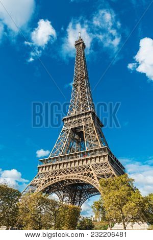 Low angle view of Eiffel Tower against sky on sunny day, Paris, France