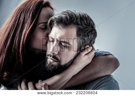 Forever Yours. Pleasant Cute Lovely Couple Spending Time Together In The Bright Room Hugging Each Ot
