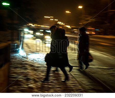 Busy City Street People On Zebra Crossing At Night. Intentional Motion Blur