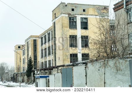 Dilapidated Abandoned Multi-storey Building On Natural Background