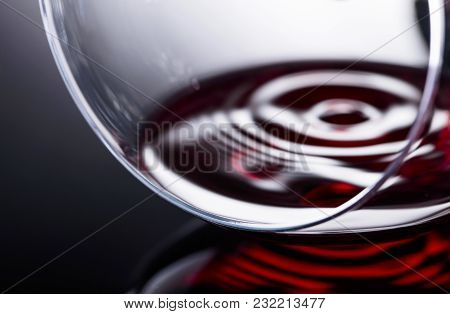 Glass Of Red Wine, Macro Shot , Black Reflective Background.