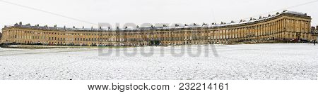 The Royal Crescent In Bath In The Snow. Winter View Of The Spectacular Georgian Architecture In The