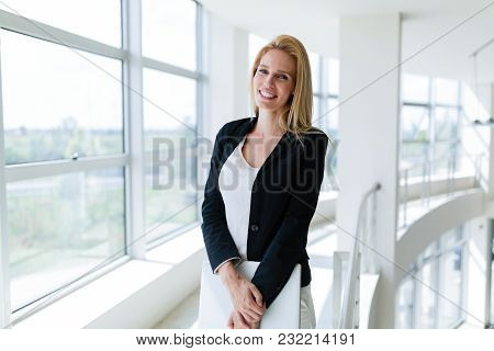 Picture Of Professional Female Salesperson Working In Car Dealership